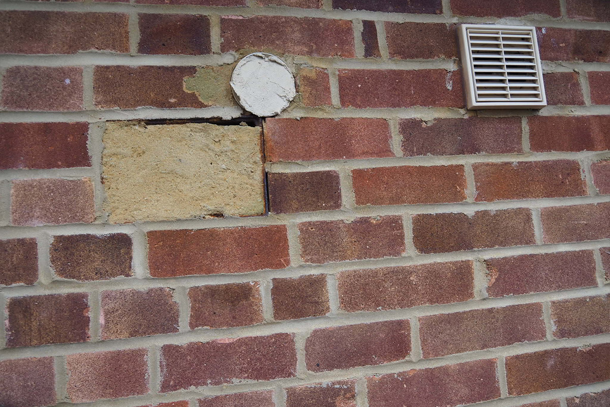 Work on bricks after the fitting of extractors and a boiler replacement